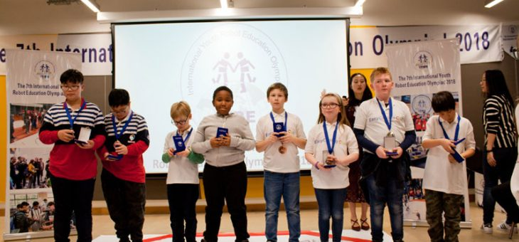 EasyCoding Club Team winning gold medals at 7th International Youth Robotics Olympiad at University College London (UCL)